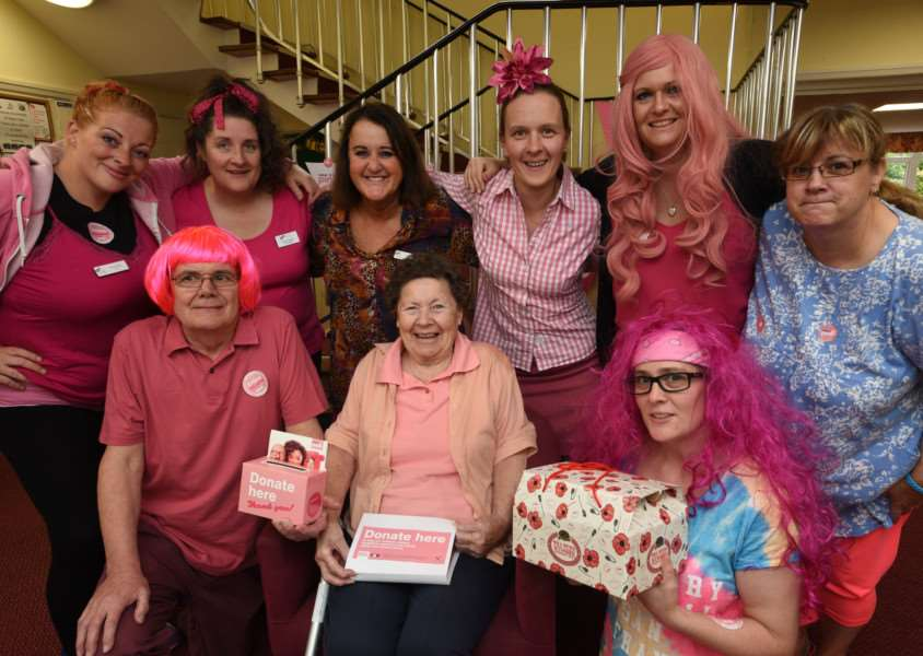 Joan Coombes (88) with staff of Digby Court, Bourne having a pink day for breast cancer EMN-151024-000152009