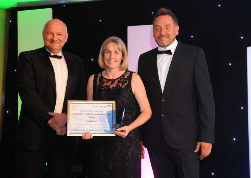Peterborough Telegraph editor Mark Edwards with Julie Holroyd and awards host Kev Lawrence.