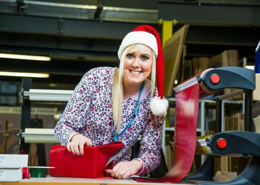 Amazon gift wrapper Cheryl Wilson. Amazon has recruited an army of 500 present wrappers - who will get through 300 MILES of gift wrap this Christmas. The UK's biggest online retailer has bought in 12,000 rolls of decorative ribbon - which would stretch for 700 miles if laid out - and 16 MILLION gift tags. Bosses reckon their 500 specially-trained wrapping recruits will use more than 50 square miles of red and silver gift wrap. If laid out flat, the rolls of wrapping paper would stretch from London to Newcastle. Photo: SWNS