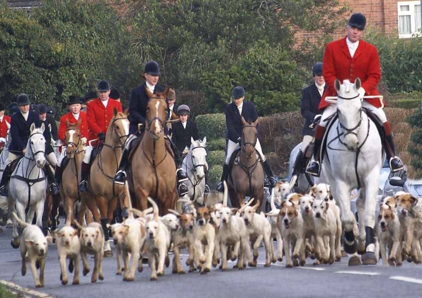 Memebers of the Cottesmore Boxing Day hunt pass through Burley Road. Photo: Terry Loomes ENGEMN00120131230101245