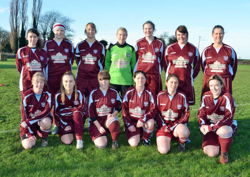LEAGUE LEADERS: Bourne Ladies before Sunday's game, back from left, Lottie Ayers, Sarah Tucker, Jemma Smith, Judith Jagger, Rachel Garratt, Sammy Hawkins, Lisa Richardson; front, Becky Cope, Kim Fairweather, Rosie Baker, Claire Lawrenson, Helen Barker, Tracey Duxbury-Mead. Photo: SG100116-301