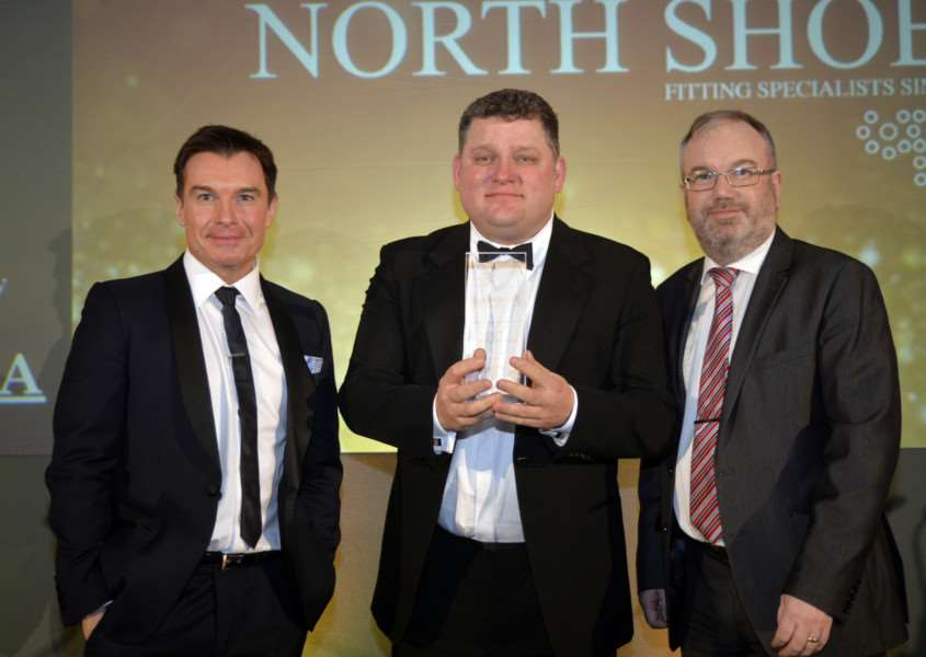 James North, pictured centre proudly displays the men's independent footwear retailer of the year award alongside Greg Burns, left and Michael Donaghy, past president of Independent Footwear Retailers Association EMN-160224-093542001