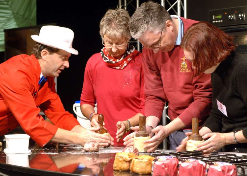 This photo, taken at last year's Melton Mowbray Food Festival, shows baker and Dickinson and Morris managing director Stephen Hallam giving tips to visitors on how to make a hand raised pork pie EMN-160723-163813001