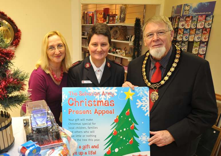 Bourne Mayor, Bob Russell with Salvation Army Captain Wendy Brown and Sally Annes shop manager Beth Grief at the launch of their Christmas Present Appeal EMN-141125-175618009