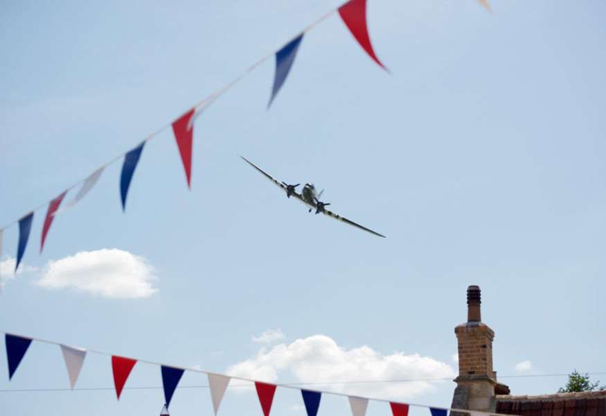 A Dakota flies over the Market Place as part of the Corby Glen Big Lunch.