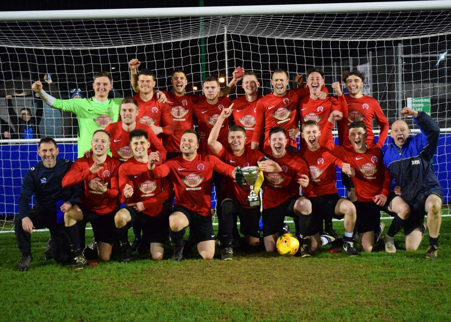 Paul O'Berg (front row, far left) celebrates with his Uppingham team after their cup final success on Tuesday night. (7625023)