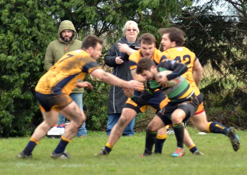 Matty Morton (right in green jersey) put in a creditable performance at full back for Deepings in their 48-14 defeat at Northampton Men's Own. Photo by Tim Wilson.