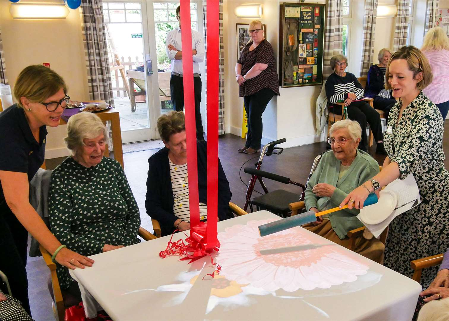 Caroline Scott, far right, teaches residents how the magic table works