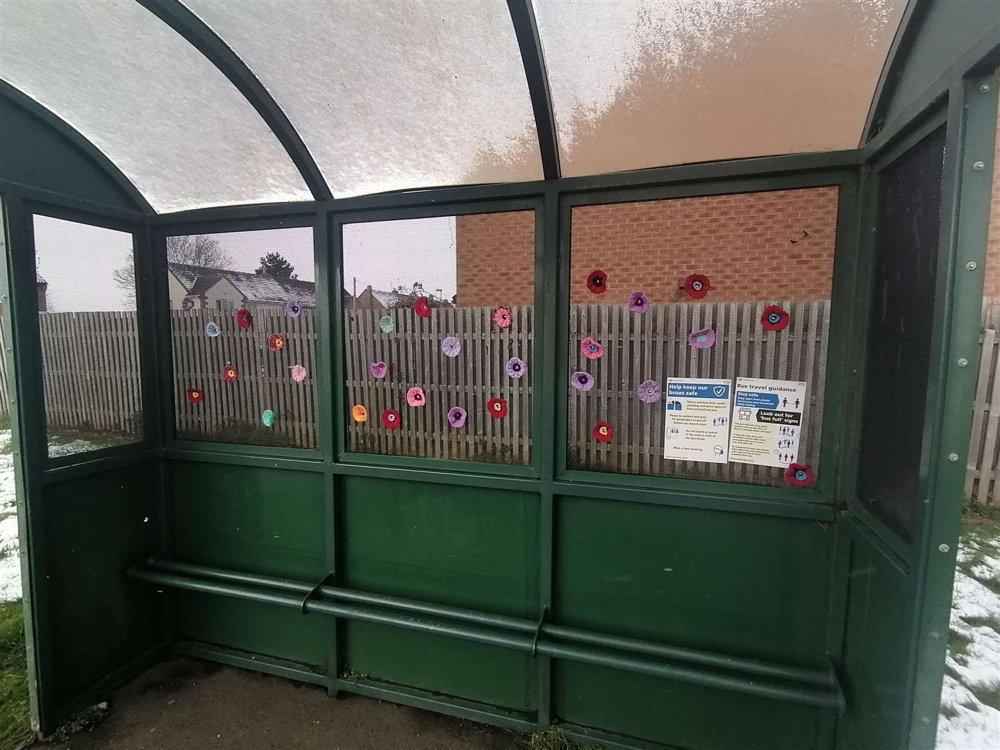 Knitted flowers decorate the bus shelter at Towngate East in Market Deeping. Photo Chris Dixon