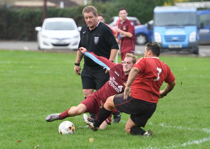 Kirton's Darren Eldin clashes with FC Hammers' Chris Brocklesby.