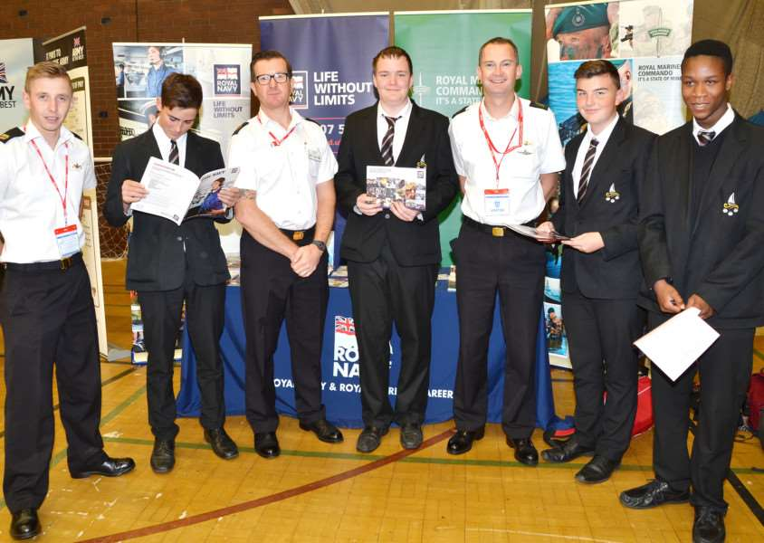 Year 11 students meet Royal Navy officers Matthew Wardell, Richie Gray and Kevin Matthias at The Deepings School's annual Post-16 options and careers fair. Photo by Tim Wilson.