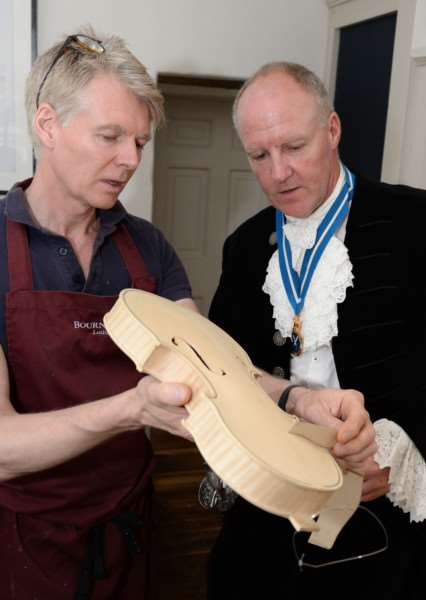 Uppingham Big Shop. Richard Moakes demonstrates violin construction to High Sheriff Andrew Brown. Photo: Alan Walters MSMP-02-07-15-aw001 EMN-150307-101123001