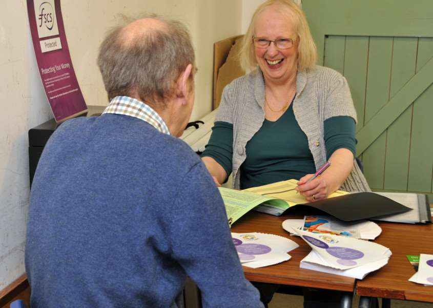Volunteer Jane Francis sees a client at The Reading Rooms, Holbeach, one of six access points in the county for Lincolnshire Credit Union. Photo by Tim Wilson.