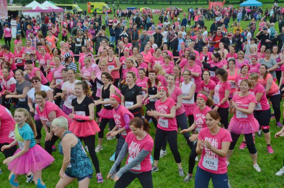 Runners in the Race for Life Pretty Muddy event at Burghley Park. EMN-160406-204434009