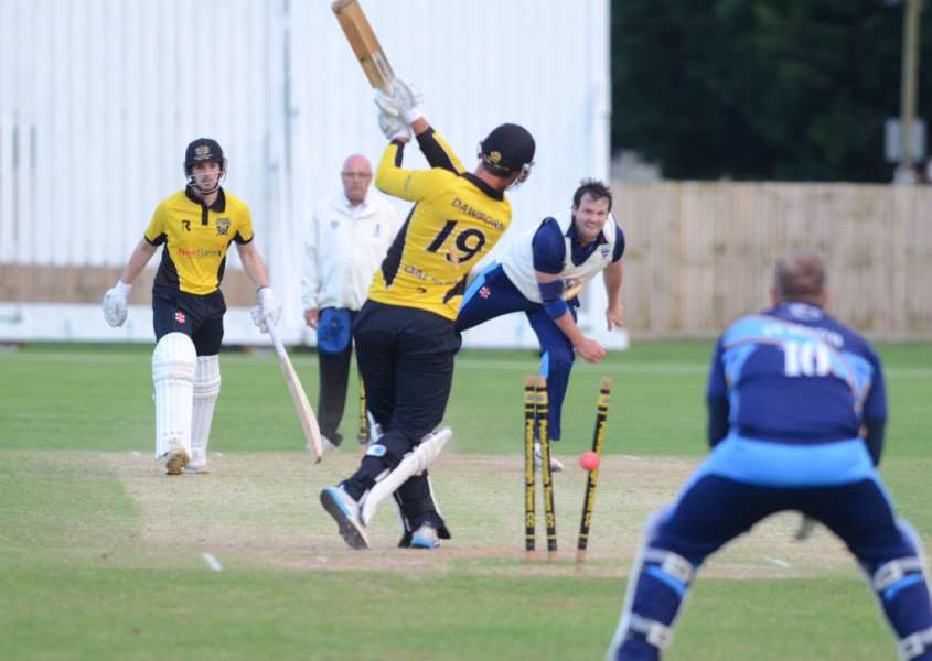 Peterborough Town's Joe Dawborn is clean bowled by Bourne's hat-trick hero Colin Cheer.