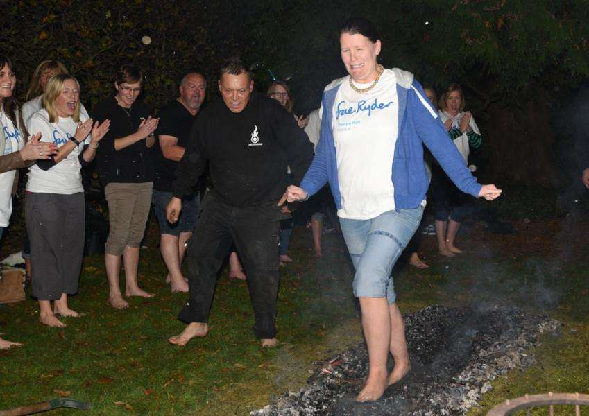 Sue Ryder fire-walking at Thorpe Hall. Kerry Coupe walking the hot coals EMN-151031-225303009