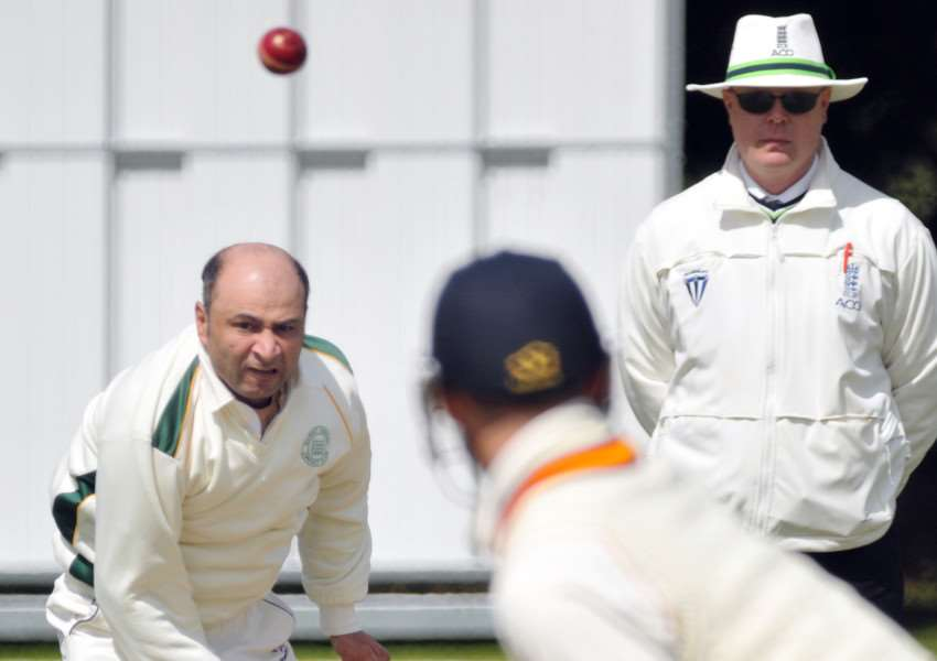 Meli Adatia during his miserly spell of bowling for Market Deeping against Lincoln. Photo: Tim Wilson.