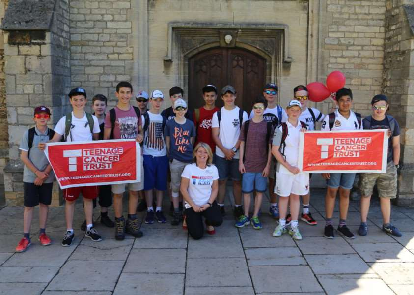 Year 9 students about to set off, and Helen Bearfield-Swift from Teenage Cancer Trust. EMN-150714-154723001