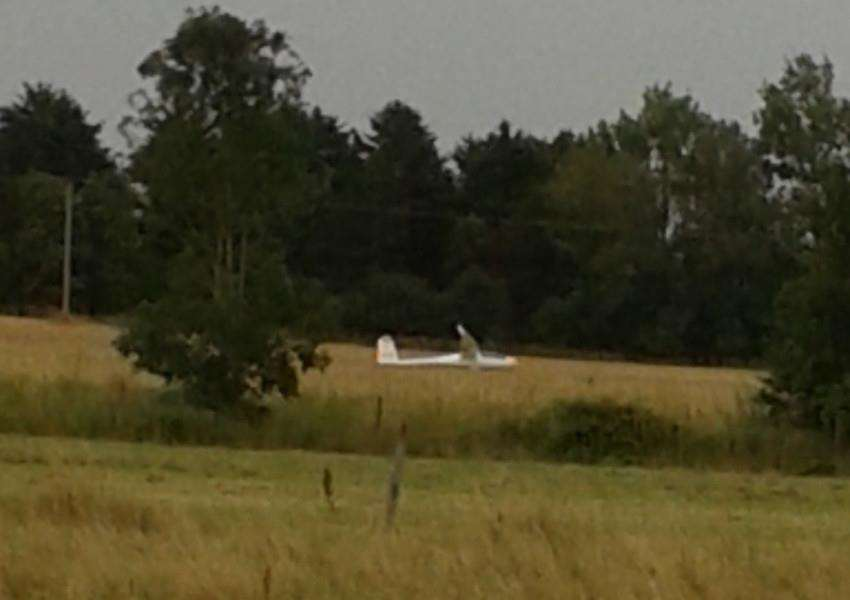 A red and white glider made an unexpected landing in a field off Station Street, Rippingale, on Saturday. Photo supplied.