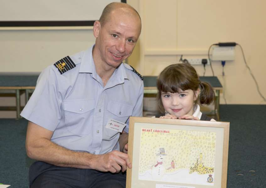 Group Captain Rich Pratley and Sophia Cretu, with her winning card