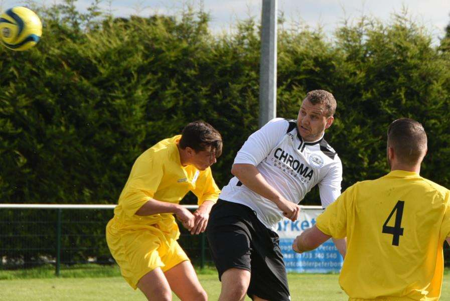 Whittlesey Athletic dangerman Matt Heron (white).