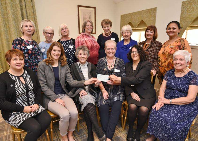 Cheque presentation from Burghley Park and Peterborough Ladies fundraising committee to Cancer Research UK at William Cecil Hotel, Stamford EMN-161025-173254009