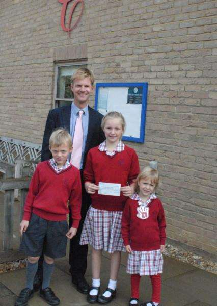 Headmaster of Copthill School, John Teesdale with pupils, from left to right, Otto Stone, Rosie Sly and Phoebe Crowson EMN-150916-143528001
