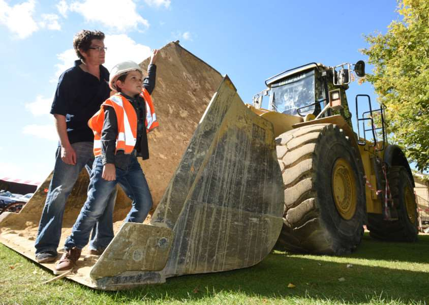 Ketton village fete. Max westwood (7) and James lake looking at the machinery from the nearby quarry on display at the fete EMN-150927-170548009