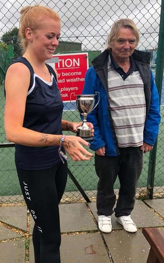 Abi Lester receives the ladies' singles cup from acting chairman Alan Jones.