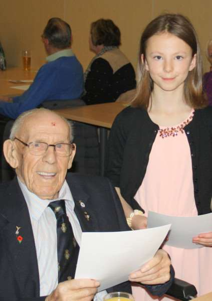 Stamford Poppy Appeal 2015. Lincolnshire Royal British Legion chairman presents awards to the oldest and youngest volunteers of the Stamford branch, Cliff Shepherd, 102, and Teagan Broughton, 10. EMN-160501-111848001