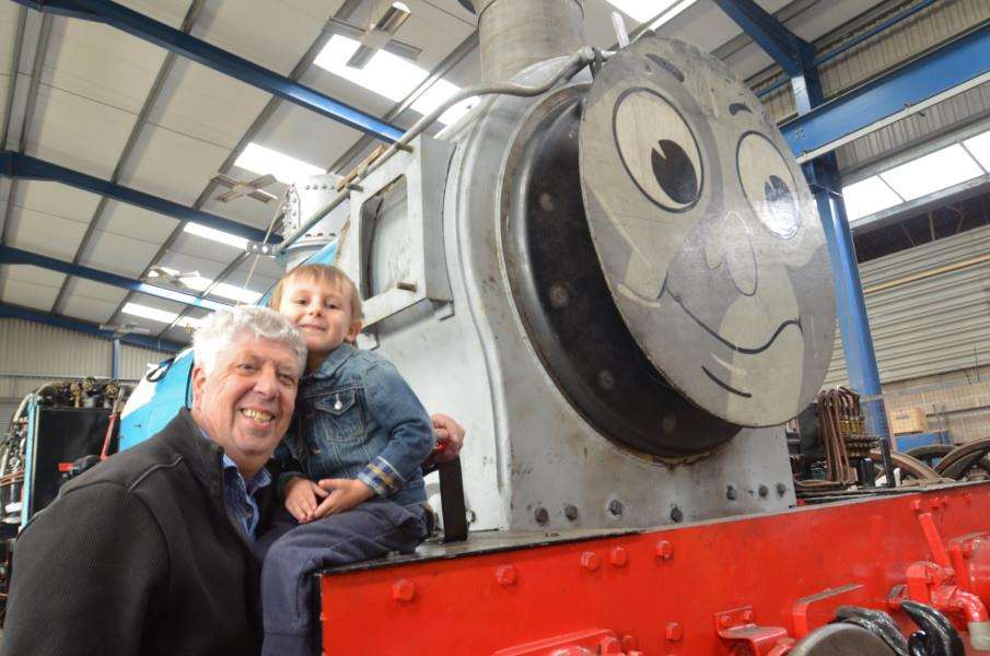 Open day at Nene Valley Railway at Wansford. The shed tour where engines are repaired. David Donnor and Harry Wyn-Donnor looking at Thomas EMN-160514-171252009