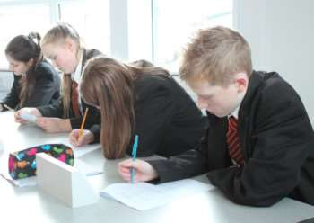 Pupils at work in the new science labs at Charles Read Academy. EMN-150126-144419001